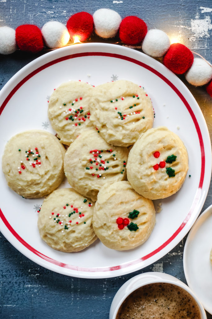 Baked cookies on a white plate with red rim