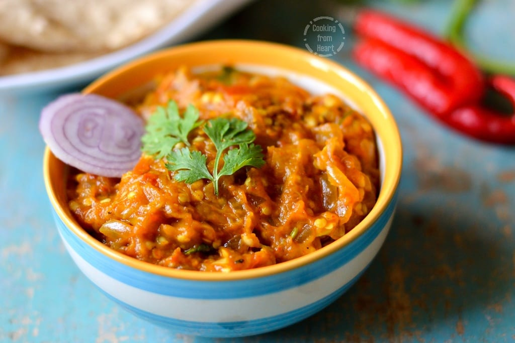 Baingan bharta smoked eggplant curry cooking from heart baingan bharta is a simple punjabi or north indian curry made with smoked or open fire roasted eggplant along with onions tomatoes and indian spices forumfinder Choice Image