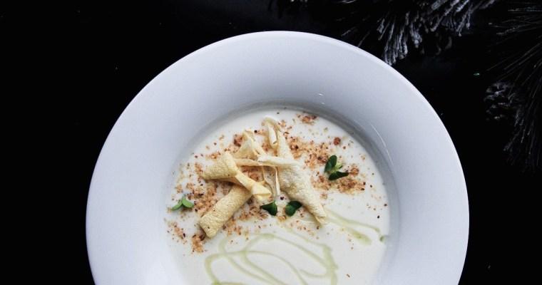 Cauliflower cream soup with gorgonzola, smoked almonds and aloe honey
