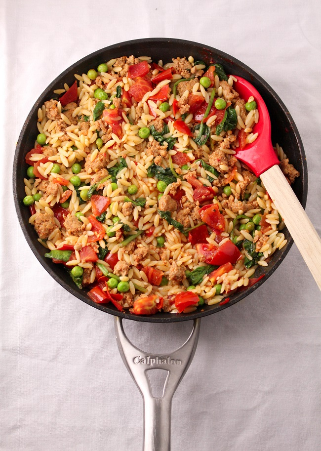 Orzo with sausage, tomatoes, and spinach