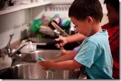 child-wash-dishes