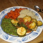 vegetarian meal with peas, rice, carrots and zucchini
