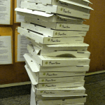 Tower of empty pizza boxes