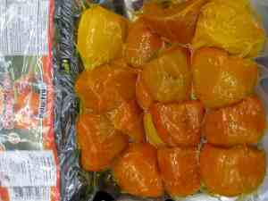 Yellow palm fruit, cubed and packaged.