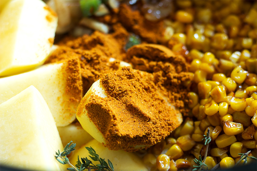 This corn chowder recipe is warming from the curry powder. It's made with fresh shaved corn that's roasted and cooked in the slow cooker until it is creamy. Make it today!