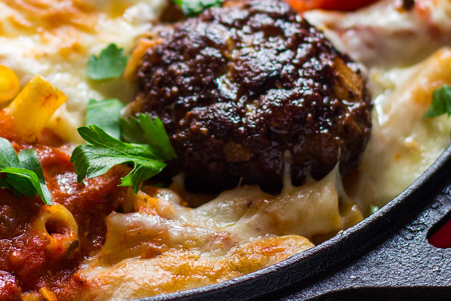 This recipe for giant meatball baked ziti is a must, just knowing that a hot, bubbly pan of delicious baked ziti with giant meatballs were just minutes away