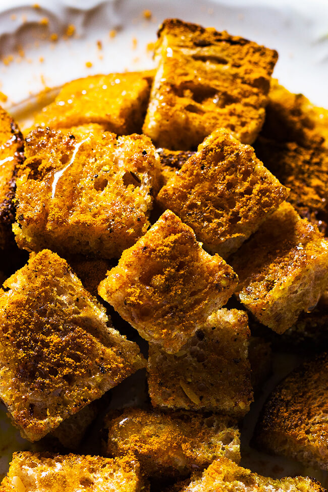 This basic curry crouton recipe is the perfect addition to any salad or soup. What's not to love about bread, curry powder, honey and butter.