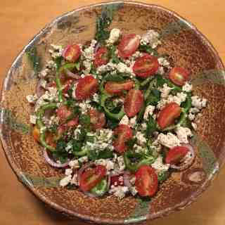 Greek Tomato Salad in a bowl by Bandana Pottery.