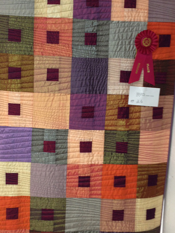 I love the motion of the quilting in this one.