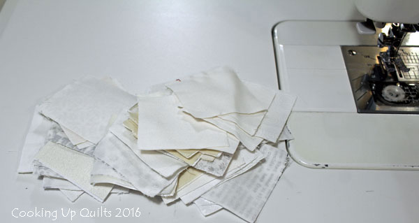 2-1/2 squares white scrap fabric