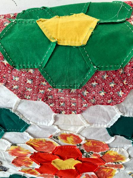 Hand pieced hexie quilt