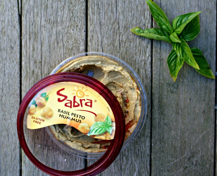Sabra basil pesto hummus is delicious, but even better in this recipe for Avocado Tomato Basil Pesto Hummus Pasta Salad!