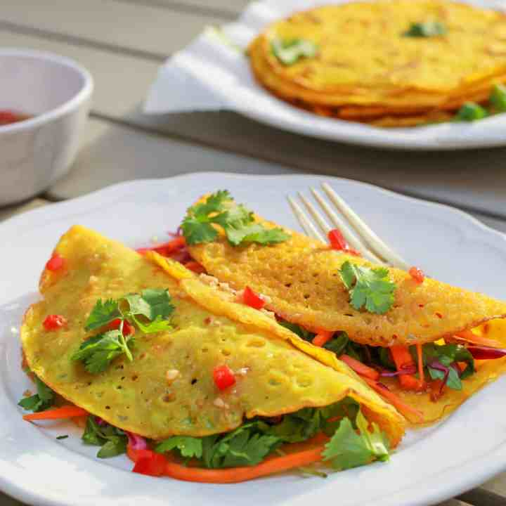 folded Vietnamese coconut pancakes filled with crunchy spicy salad