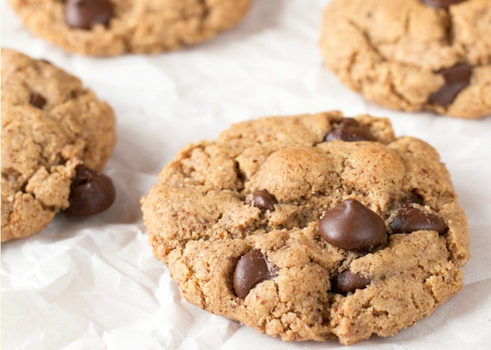 Up close picture of almond butter chocolate chip cookies on waxed paper