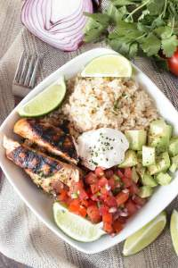 Top down photo of a Grilled Chicken Burrito Bowl on a dish towel.
