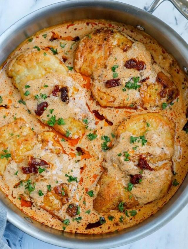 Creamy cajun chicken in a skillet.