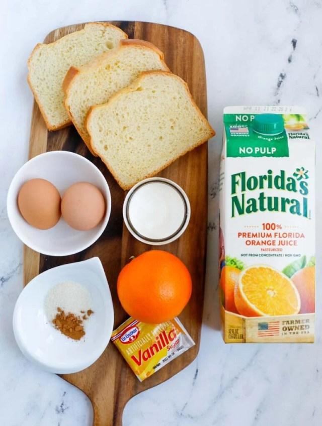 Ingredients needed to make orange French toast.