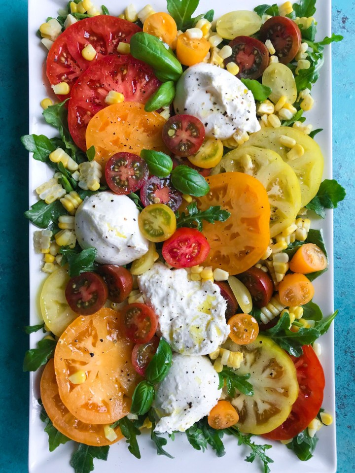 top down shot of Tomato and Burrata Salad on a plate
