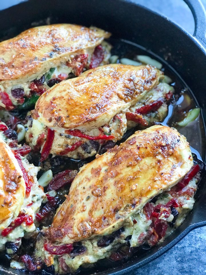 Cheesy Sundried Tomato Stuffed Chicken in a skillet