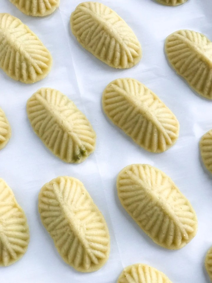 Unbaked Maamoul Cookies on parchment paper
