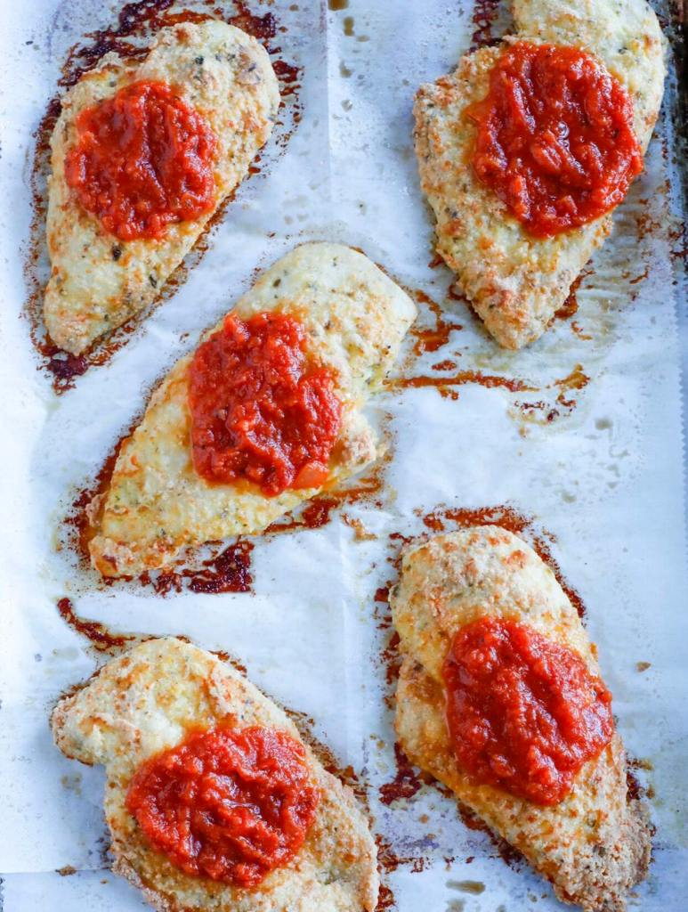 Baked parmesan chicken with marinara on top