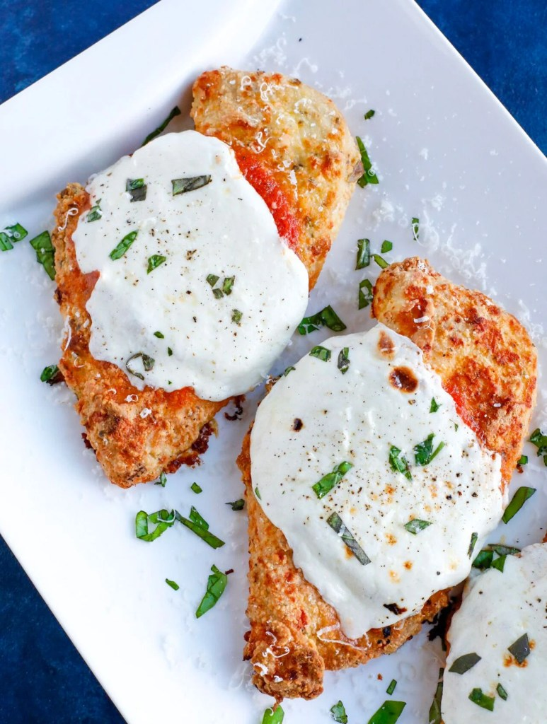 Baked Parmesan Chicken with cheese and basil