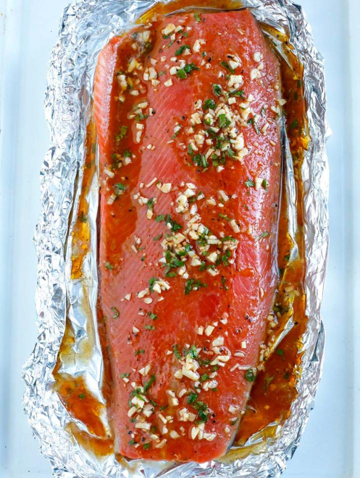 overhead shot of Marinated salmon fillet in foil