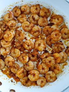 Fajita seasoned shrimp cooking in a skillet.