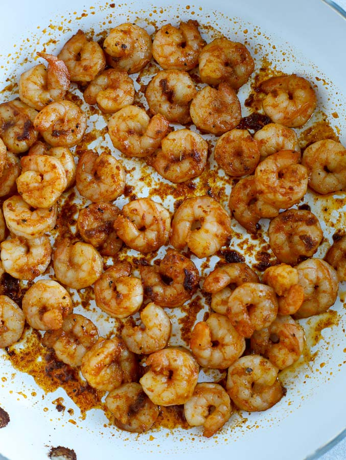 Southwest seasoned shrimp cooking in a skillet.