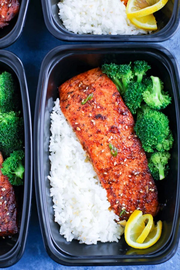 A meal prep box with spicy honey garlic salmon, rice, and broccoli.