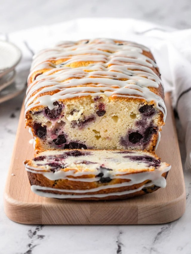 a slice of blueberry lemon bread cut out showing the center