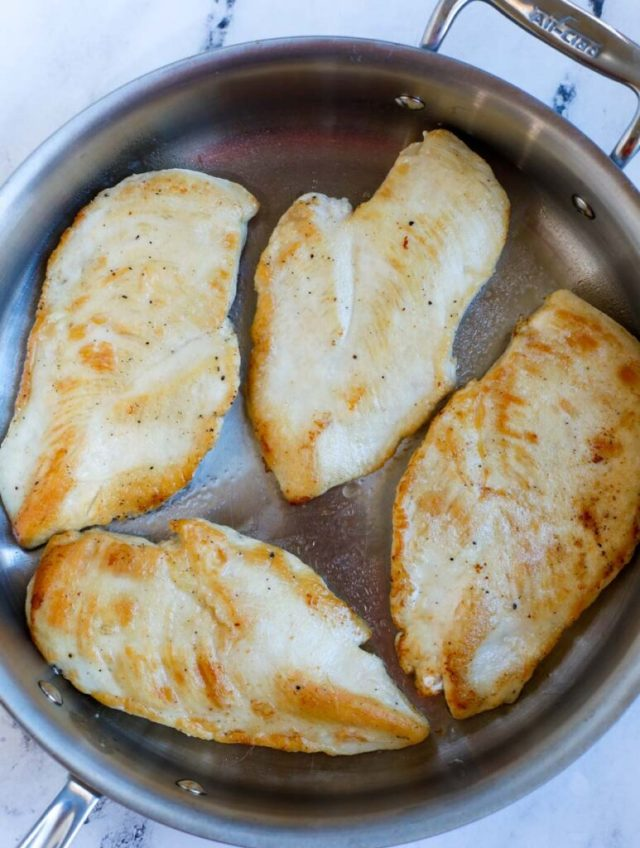 Pan searing chicken breasts.