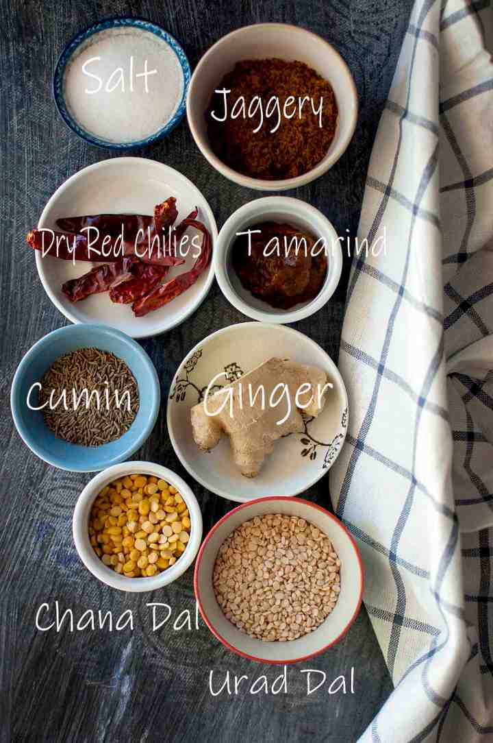 Ingredients needed to make ginger chutney - fresh ginger, urad, chana, cumin, dry red chilies, salt, jaggery & tamarind paste