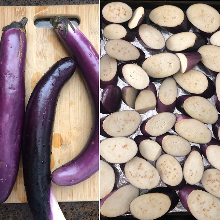 Chopping board with 3 long Chinese eggplants and a foil lined baking sheet with sliced eggplant