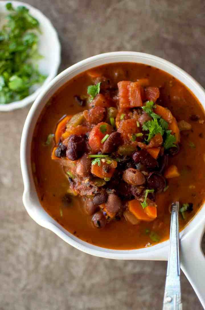 White bowl with vegetarian 3 bean stew