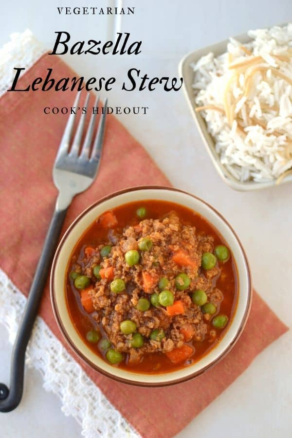 Bowl with vegetarian stew made with faux meat, carrots and green peas