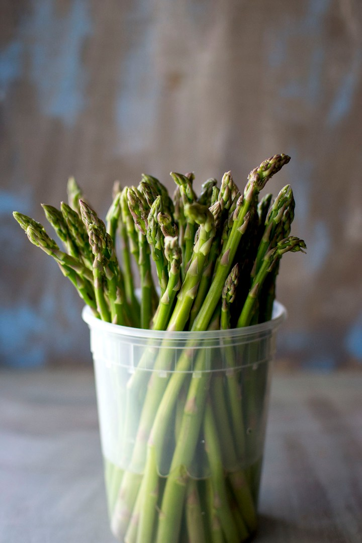 Plastic Container with fresh asparagus
