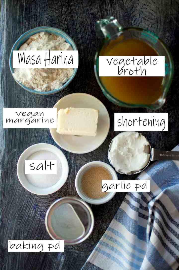 Ingredients for the dough - masa harina, margarine, shortening, vegetable broth, garlic powder, salt, baking powder