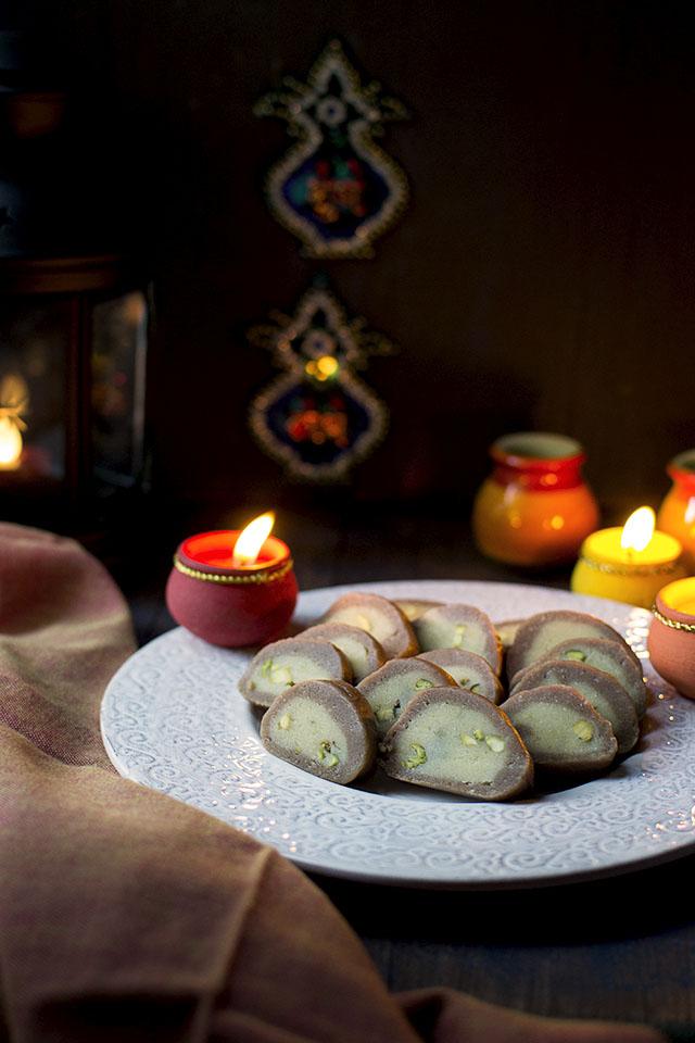 Platter of chocolate pistachio dessert rolls for diwali
