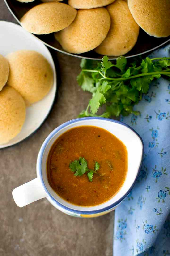 Bowl of Instant Sambar with vegetables with idli