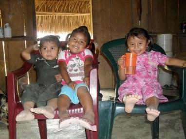 Mopan Maya Girls Take a Rest While their Mother's Bake Tortillas