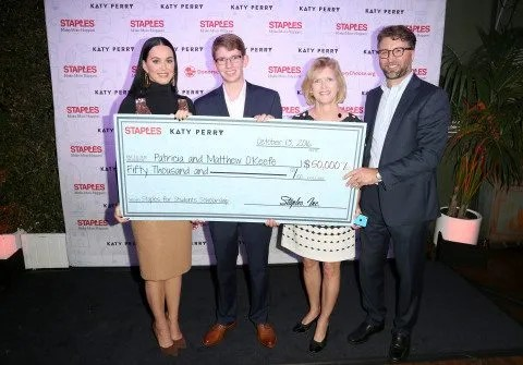 Global superstar Katy Perry and Staples for Students Sweepstakes grand prize winner Patricia O'Keefe and her son Matthew and William Durling of Staples, attend the sweepstakes Winners VIP Celebration on Thurs., Oct. 13, 2016, in Los Angeles. The sweepstakes grand prize included a $50,000 scholarship and a trip to Los Angeles with a guest to meet Katy Perry. In April, as part of the Staples for Students program, Staples partnered with Perry to announce a $1 million donation to DonorsChoose.org. As a result, Staples fulfilled 1,072 classroom projects on DonorsChoose.org, providing 787 teachers and impacting 98,609 students across the country. Additionally, Staples customers donated more than $330,000 to DonorsChoose.org at Staples stores and at www.StaplesForStudents.com throughout the back-to-school season. (Casey Rodgers/AP Images for Staples)