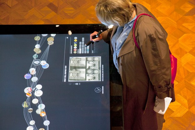 A museum visitor looking at an image on the Digital Table. Photo by Matt Flynn.