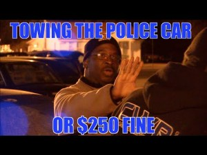 Pay $250 Fine or Patrol Car Gets Towed, Illegally Parked Cop Gets a Taste of Police Extortion (VIDEO)