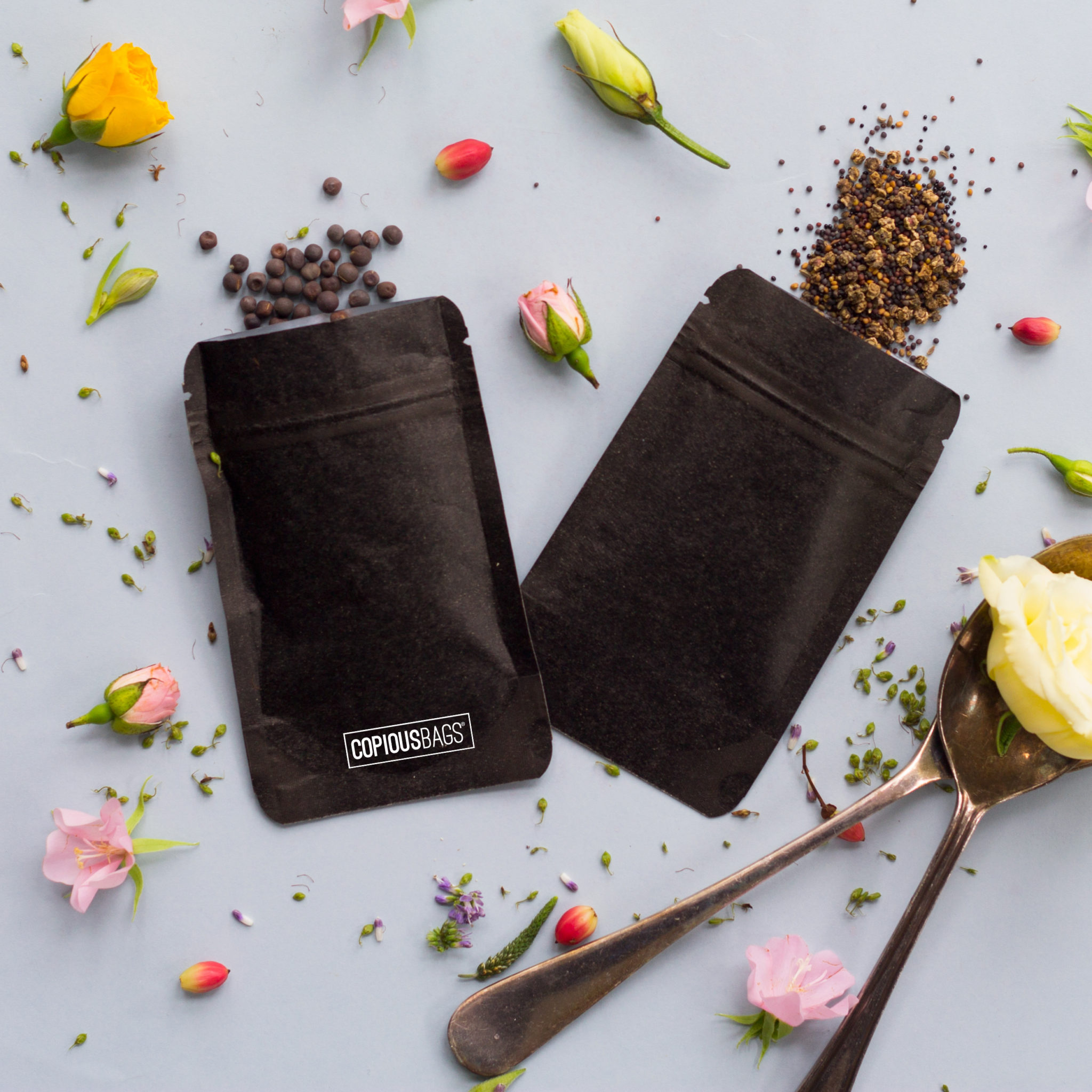 1 oz black kraft stand up pouch - herbs and spice packaging - Copious Bags®