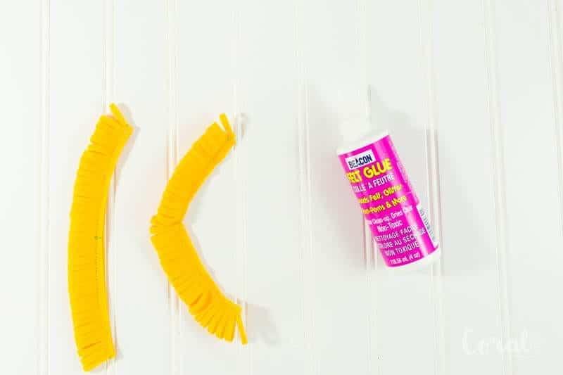 add-glue-to-felt-flower-fabric-piece-and-roll