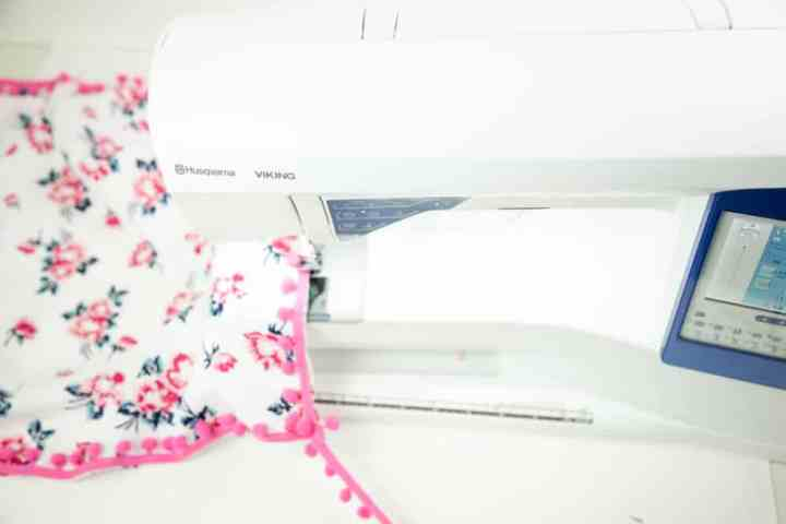 how-to-sew-pom-poms-on-a-pillow