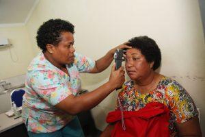 Nurse Maria checks a patients eye at the Sigatoka Hospital