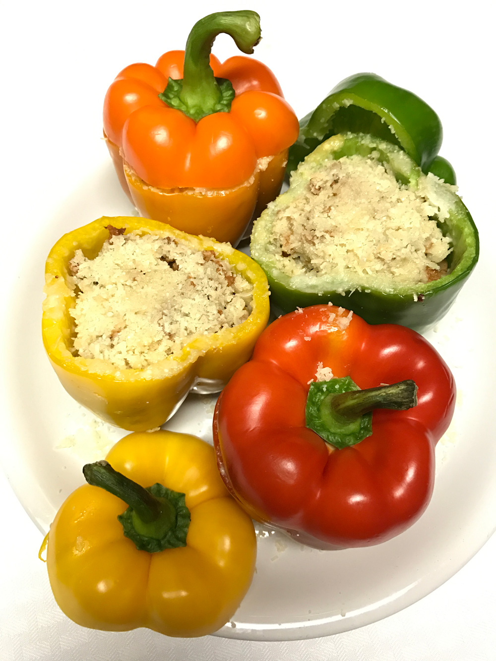 Stuffed Bell Peppers Recipe sprinkled with Parmigiano Reggiano