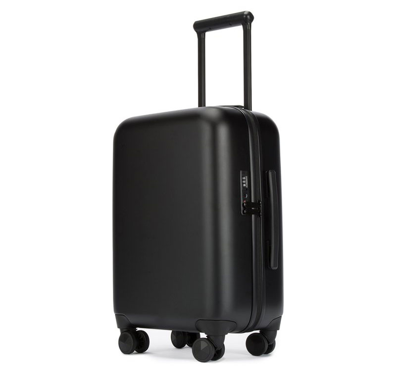 Best Travel Gift Ideas: Rebeca Minkoff suitcase charges your phone or laptop.